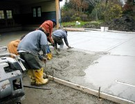 The team works fast to pour and trowel and finish the surface