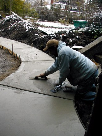 Washed aggregate walkway is tooled