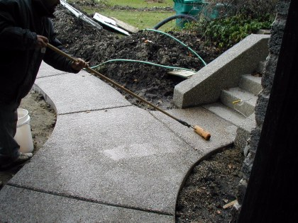 Sealer is applied to washed aggregate walkway