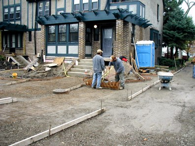 Forms and wire being placed for pouring driveway