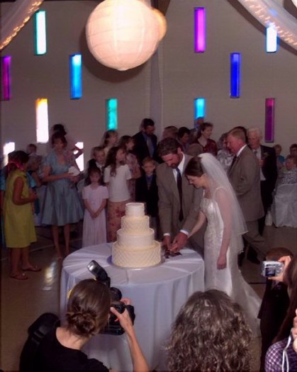 Cutting their wedding cake