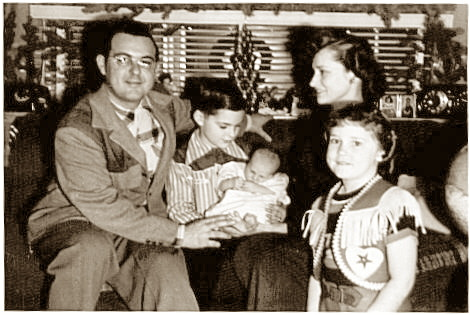 Little Tommie is introduced to Grask Trailer Sales and the rest of his family in this January 2, 1952, photo