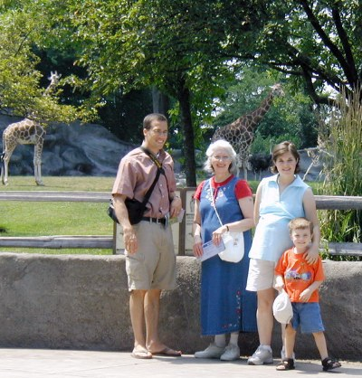 Three generations enjoy the fresh air and the animals together
