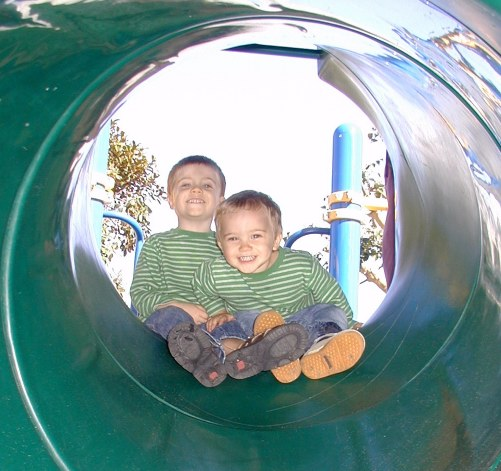 Nicholas and Ian enjoying a turn on the slide